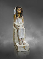 Female ancient Egyptian statue, New Kingdom, 18th Dynasty, (1480-1390 BC), Thebes Necropolis. Egyptian Museum, Turin. Grey background. Drovetti collection. .<br /> <br /> If you prefer to buy from our ALAMY PHOTO LIBRARY  Collection visit : https://www.alamy.com/portfolio/paul-williams-funkystock/ancient-egyptian-art-artefacts.html  . Type -   Turin   - into the LOWER SEARCH WITHIN GALLERY box. Refine search by adding background colour, subject etc<br /> <br /> Visit our ANCIENT WORLD PHOTO COLLECTIONS for more photos to download or buy as wall art prints https://funkystock.photoshelter.com/gallery-collection/Ancient-World-Art-Antiquities-Historic-Sites-Pictures-Images-of/C00006u26yqSkDOM