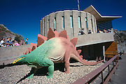 Paleontologists have chiseled the remains of several hundred Jurassic dinosaurs since work began in 1909 near Jensen, Utah. A building was put over the site in 1958 to preserve the bones, which attract nearly 500,00 visitors per year.Stegasaurus Model Outside the Main Building