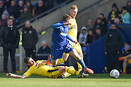 AFC Wimbledon defender(on loan from Birmingham City) Steve Seddon (15) skips a tackle during the EFL Sky Bet League 1 match between Oxford United and AFC Wimbledon at the Kassam Stadium, Oxford, England on 13 April 2019.
