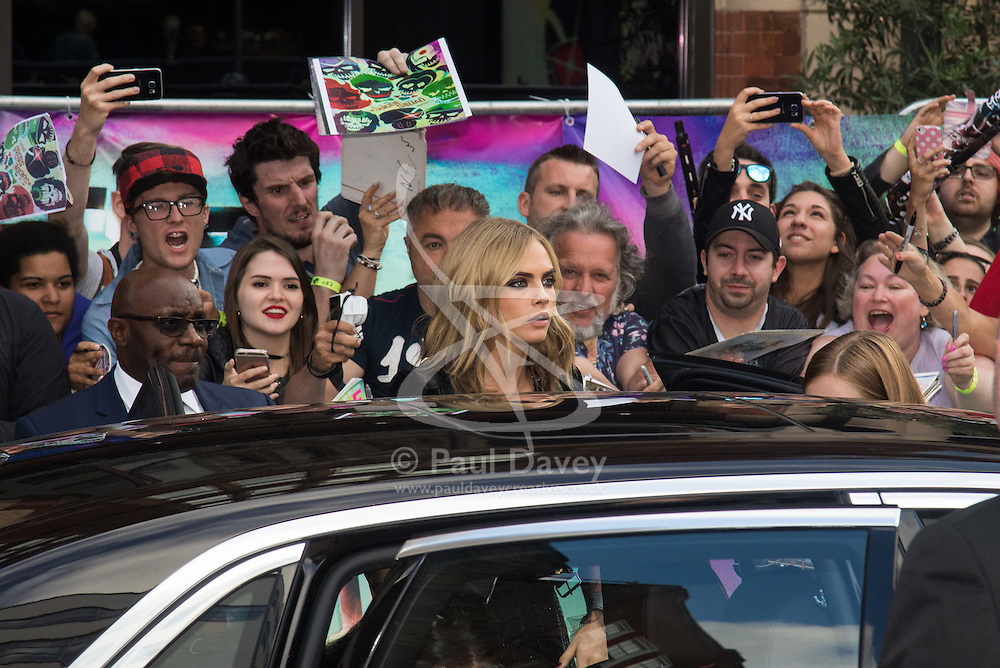 Leicester Square, London, August 3rd 2016. Hundreds of fans greet the stars of Suicide Squad at the film's European premiere in London's Leicester Square. Stars attending include: Jared Leto, Joel Kinnaman, Jai Courtney, Jay Hernandez, Adewale Akinnuoye-Agbaje, Cara Delevingne, Karen Fukuhara David Ayer (Director) Richard Suckle and Charles Roven (Producers). PICTURED: Cara Delevingne
