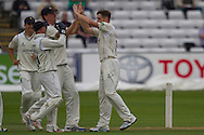 Chris Woakes (Warwickshire County Cricket Club) celebrates after taking the wicket of Mark Stoneman (Durham County Cricket Club) during the LV County Championship Div 1 match between Durham County Cricket Club and Warwickshire County Cricket Club at the Emirates Durham ICG Ground, Chester-le-Street, United Kingdom on 14 July 2015. Photo by George Ledger.