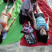 Asian Tourists in Boracay, The Philippines.