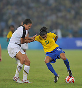 Beijing, CHINA.   Olympic Football, Women's Gold  Medal Game, USA vs BRA, Brazils MARTA, holds of a defender, during the first half at the Beijing Workers Stadium. Thursday,  21.08.2008 [Mandatory Credit: Peter SPURRIER, Intersport Images]