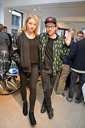 FLORA OGILVY and PHILIP COLBERT at a private view of Bright Young Things held at the David Gill Gallery, 2-4 King Street, London on 19th April 2016.