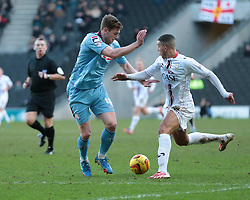 Milton Keynes Dons' Daniel Powell turns inside Tranmere Rovers' Ash Taylor  - Photo mandatory by-line: Nigel Pitts-Drake/JMP - Tel: Mobile: 07966 386802 01/02/2014 - SPORT - FOOTBALL - Stadium MK - Milton Keynes - MK Dons v Tranmere Rovers - Sky Bet League One