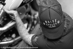 Scott Jones working on final prep on his bike at Noise Cycles the night before Born Free 6. Santa Ana, CA. USA. June 26, 2014.  Photography ©2014 Michael Lichter.