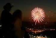 A couple watches fireworks over the Town of Woodbury as seen from the Route 6 scenic overlook in Central Valley, N.Y..July 3, 2004.