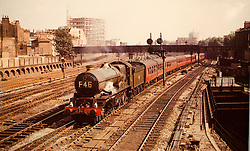 © under license to London News Pictures. 02/04/2011. The King Edward II steam locomotive pictured here in 1960 near Padington Station.  The KEII was today (02/04/2011) revealed to the public in it's full glory at the Railway Centre in Didcot, Oxfordshire, England. A group of volunteer workers have spent the last 20 years working on restoring the heavy express steam locomotive to full working order. The splendid machine first introduced in the 1920's spent many years rotting at Barry Scrapyard in Wales after performing over 1,500,000 miles of service pulling trains between London Paddington and the West of England for Great Western Railway. Photo credit should read: London News Pictures