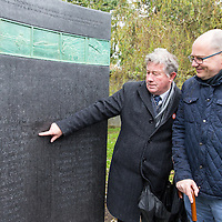 Michael Guilfoyle and Brian O'Neill admiring the new memorial in Ennis