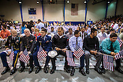 04 JULY 2012 - PHOENIX, AZ:  Current and former members of the US military wait to be naturalized as US citizens in Phoenix Wednesday. About 250 people, from 62 countries, were naturalized as US citizens during the 24th Annual Fiesta of Independence naturization ceremony at South Mountain Community College in Phoenix Wednesday. The ceremony was presided over by the Honorable Roslyn O. Silver, Chief United States District Court Judge.   PHOTO BY JACK KURTZ