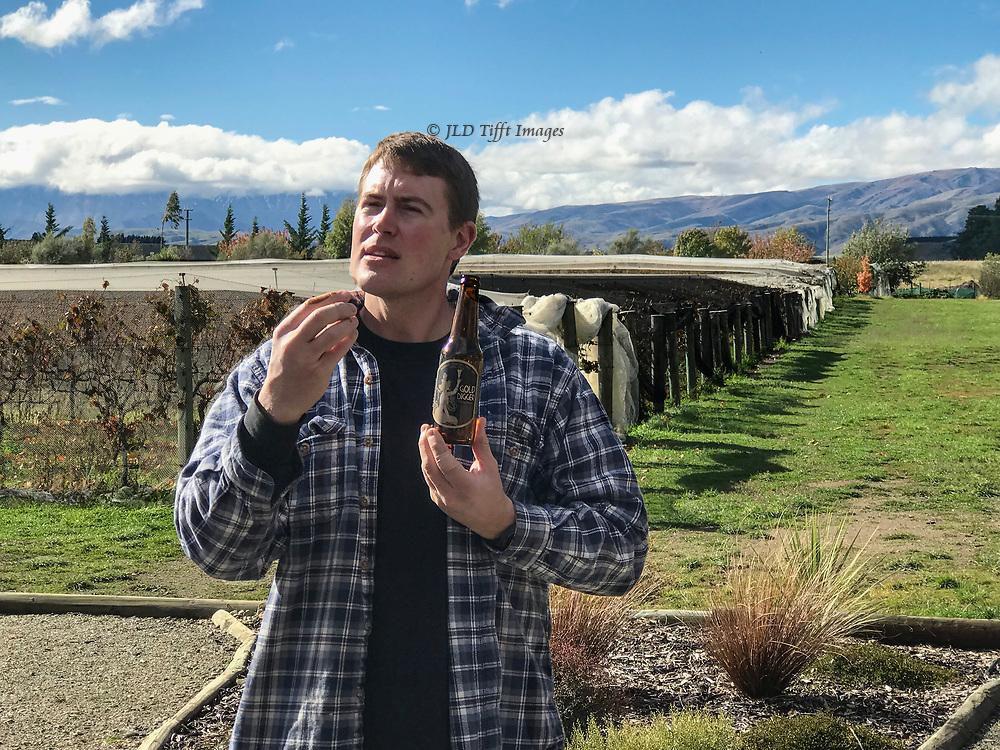Vintner describing his pinot noir at Maori Point vineyard