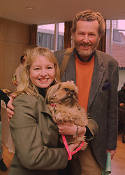 Actress LIZA GODDARD, her husband MR DAVID COBHAM with their dog Mina, at a lunch in London on 1st March 1998.MFW 30