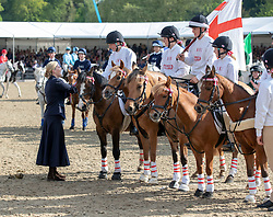 The Countess of Wessex presents rosettes to the winning team in the DAKS Pony Club Mounted games Royal Windsor Horse Show at Windsor Castle, Berkshire.