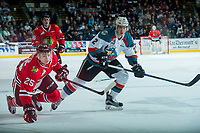 KELOWNA, CANADA - APRIL 8: Evan Weinger #25 of the Portland Winterhawks gets tripped up by James Hilsendager #2 of the Kelowna Rockets during second period on April 8, 2017 at Prospera Place in Kelowna, British Columbia, Canada.  (Photo by Marissa Baecker/Shoot the Breeze)  *** Local Caption ***