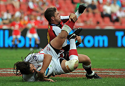 JOHANNESBURG, South Africa, 02 April 2011. Saia Faingaa of the Reds looses his balance in the tackle from Andre Pretorius of the Lions during the Super15 Rugby match between the Lions and the Reds at Coca-Cola Park in Johannesburg, South Africa on 02 April 2011. .Photographer : Anton de Villiers / SPORTZPICS