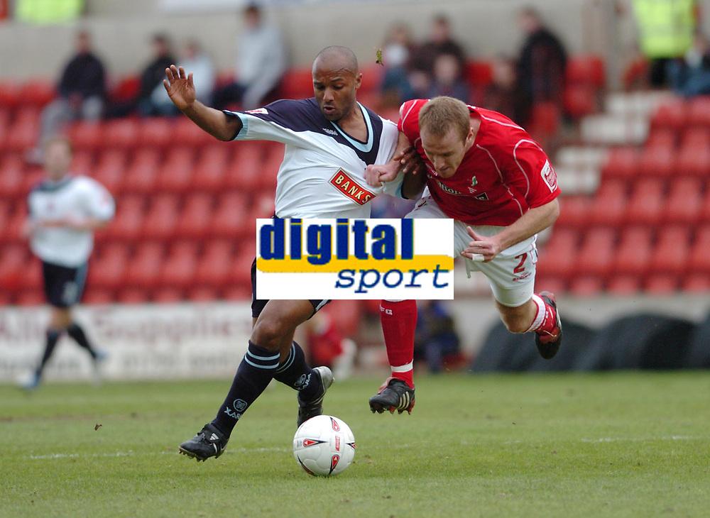 Photo. Leigh Quinnell.  Swindon Town v Walsall Coca Cola league one. 09/04/2005. Walsalls Julian Joachim battles with Swindons Sean O'Hanlon.