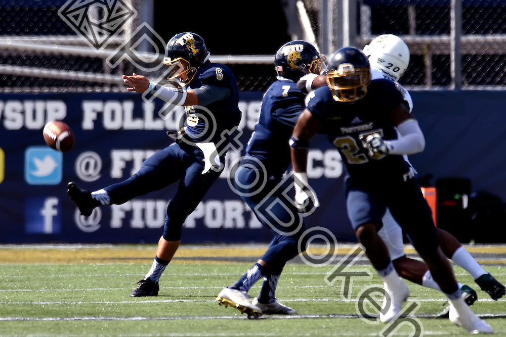 2015 November 07 - FIU's Stone Wilson (6). Florida International University defeated Charlotte, 48-31, at Ocean Bank Field, Miami, Florida. (Photo by: Alex J. Hernandez / photobokeh.com) This image is copyright by PhotoBokeh.com and may not be reproduced or retransmitted without express written consent of PhotoBokeh.com. ©2015 PhotoBokeh.com - All Rights Reserved