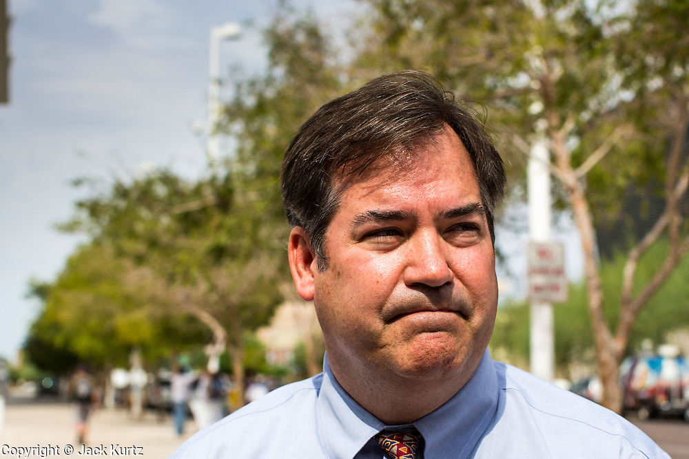 21 AUGUST 2012 - PHOENIX, AZ:   Assistant Maricopa County Attorney TOM LIDDY walks into US federal Court in Phoenix to help defend section 2B of SB1070. A handful of protesters waited outside the Sandra Day O'Connor Courthouse in Phoenix Wednesday while lawyers from the American Civil Liberties Union (ACLU) and Mexican American Legal Defense and Education Fund (MALDEF) sparred with lawyers from Maricopa County and the State of Arizona over the constitutionality of section 2B of SB 1070, Arizona's tough anti-immigrant law. Most of the law was struck down by the US Supreme Court in June, but the Justices let section 2B stand pending further review. The suit is being heard in District  Judge Susan Bolton's court. It was Judge Bolton who originally struck down SB 1070 in 2010. A ruling is expected later in the year. PHOTO BY JACK KURTZ