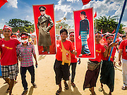 01 NOVEMBER 2015 - YANGON, MYANMAR: NLD supporters carry large pictures of Gen Aung San, Myanmar's national hero and the man credited with leading Myanmar (then Burma) to independence, and his daughter, Aung San Suu Kyi, leader of the oppositon NLD, into a NLD rally near Yangon Sunday. Political parties are wrapping up their campaigns in Myanmar (Burma). National elections are scheduled for Sunday Nov. 8. The two principal parties are the National League for Democracy (NLD), the party of democracy icon and Nobel Peace Prize winner Aung San Suu Kyi, and the ruling Union Solidarity and Development Party (USDP), led by incumbent President Thein Sein. There are more than 30 parties campaigning for national and local offices.    PHOTO BY JACK KURTZ