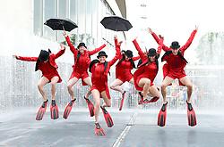 Acrobats from Spanish company Aracaladanza <br /> perform in/on Southbank roof gardens and in the waterfalls ahead of opening their new show Clouds at Queen Elizabeth Hall, Southbank, London, Great Britain <br /> 25th July 2014 <br /> <br /> Performers are:<br /> Carolina Arija<br /> Jorge Brea Salqueiro<br /> Olga Llado Valls<br /> Raquel de la Plaza Humera<br /> Jonatan de Luis Mazagatos<br /> Jimena Tryeba Toca<br /> <br /> concept / director of Choreography Enrique Cabrera<br /> Photograph by Elliott Franks