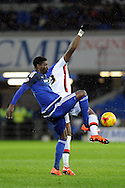 Cardiff City's Bruno Ecuele Manga (L) challenges former Cardiff striker Jay Emmanuel-Thomas.  Skybet football league championship match, Cardiff city v MK Dons at the Cardiff city stadium in Cardiff, South Wales on Saturday 6th February 2016.<br /> pic by Carl Robertson, Andrew Orchard sports photography.