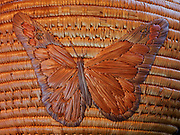 Butterfly on a large antique Yupik Eskimo grass basket from Western Alaska.