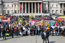 London, May 1st 2015. Hundreds of workers and Trade Unionists from across the UK are joined by Turks, Kurds and anti-capitalists as they march through London on May Day. PICTURED: Hundreds of marchers crowd into Trafalgar Square.