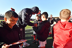 Leicester City's Demarai Gray signs autographs prior to the match