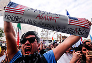 Demonstrators gather outside the Edward Roybal Federal Building to protest against President-elect Donald Trump in Los Angeles on November 12, 2016. Americans spilled into the streets Saturday for a new day of protests against Donald Trump, even as the president-elect appeared to back away from the fiery rhetoric that propelled him to the White House.