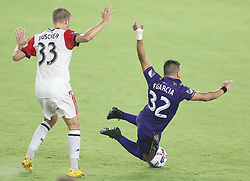 May 31, 2017 - Orlando, FL, USA - Orlando City's Matias Perez Garcia (32) falls beside D.C. United's Julian Buescher (33) at Orlando City Stadium on Wednesday, May 31, 2017, in Orlando, Fla. (Credit Image: © Stephen M. Dowell/TNS via ZUMA Wire)