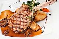 Broiled center cut veal chop with sauteed onions and mushrooms.