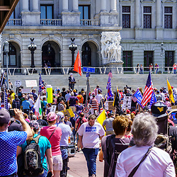 Harrisburg, PA / USA - May 15, 2020: Thousands gathered at the Capitol Building to protest Pennsylvania Governor Tom Wolf's continued quarantine lockdown and demand the reopening of the state.