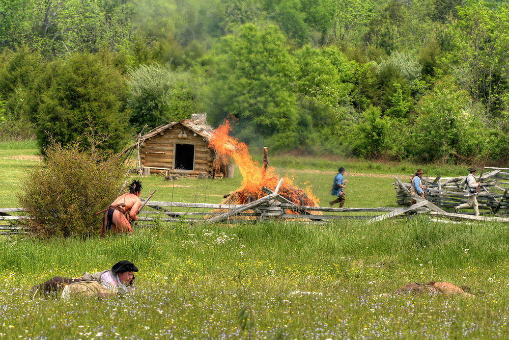 A pile of hay is set on fire during the raid at the 15th Annual Raid at Martin's Station at Wilderness Road State Park in Ewing, VA on Saturday, May 9, 2015. Copyright 2015 Jason Barnette