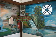 Tropical imagery and music speaker at the Délice restaurant in the old quarter of Kourou, French Guiana..