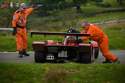Marshalls recover a race car that has just spun, Loton Park Hillclimb, near Shrewsbury, Shropshire, UK.