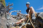 Climbers Ian Derrington (front) and Brian Polagye belay their climbing partners to the summit of Unicorn Peak during a traverse of the Tatoosh Range in Mount Rainier National Park, Washington.