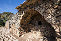 Village de Bories - thirty restored dry stone huts, made of simple shapes represent an architectural masterpiece. Without the use of mortar, the borie have been skillfully stacked into huts with vaulted ceilings, reflecting the harmony of natural materials.  The word Borie comes from the Latin boaria - oxen stable. The borie gave shelter to farmers' livestock. Village des Bories is an open-air museum near Gordes in the Vaucluse.  The origin of bories goes as far back as the Bronze Age. The village museum displays traditional objects and tools, as well as presenting the history of the Bories and dry stone architecture.