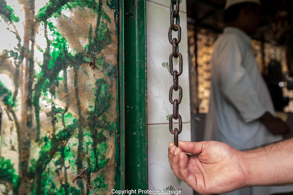 A single iron chain above a chintzy green 'Welcome' mat hangs at the entrance to the Saint shrine. This chain, Ali explained, was where the exorcisms took place. If a person was possessed they could not hold the chain and pass into the shrine, the burial place of the saint. Malevolent Djinn and the souls of the restless dead could possess people, causing great mental and physical harm.