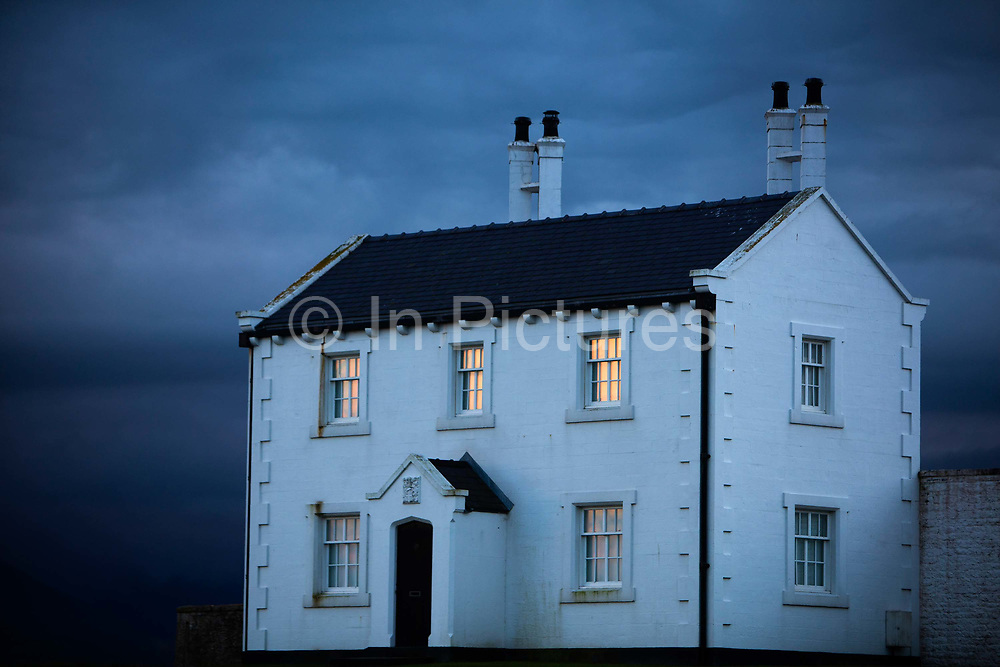 Lighthouse keepers cottage on the Penmon promontory, on the south-east tip of the Isle of Anglesey in Wales with views of Snowdonia across the Menai Strait.