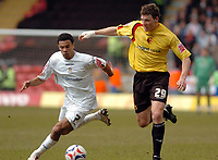 Photo: Leigh Quinnell.<br /> Watford v Luton Town. Coca Cola Championship. 09/04/2006. Watfords Darius Henderson battles with Lutons Carlos Edwards.