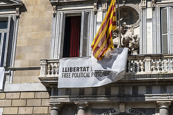 March 22, 2019 - Barcelona, Catalonia, Spain - Maintenance workers are seen removing a banner from the balcony..Finally, overcoming the deadline granted by the Central Electoral Board, President Quim Torra orders the removal of the banners in solidarity with the political prisoners from the main facade of the Palace of the Generalitat de Catalunya. (Credit Image: © Paco Freire/SOPA Images via ZUMA Wire)