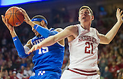 March 2, 2013; Fayetteville, AR, USA; Arkansas Razorbacks forward Hunter Mickelson (21) and Kentucky Wildcats forward Willie Cauley-Stein (15) battle for control of a rebound during a game at Bud Walton Arena. Arkansas defeated Kentucky 73-60. Mandatory Credit: Beth Hall-USA TODAY Sports