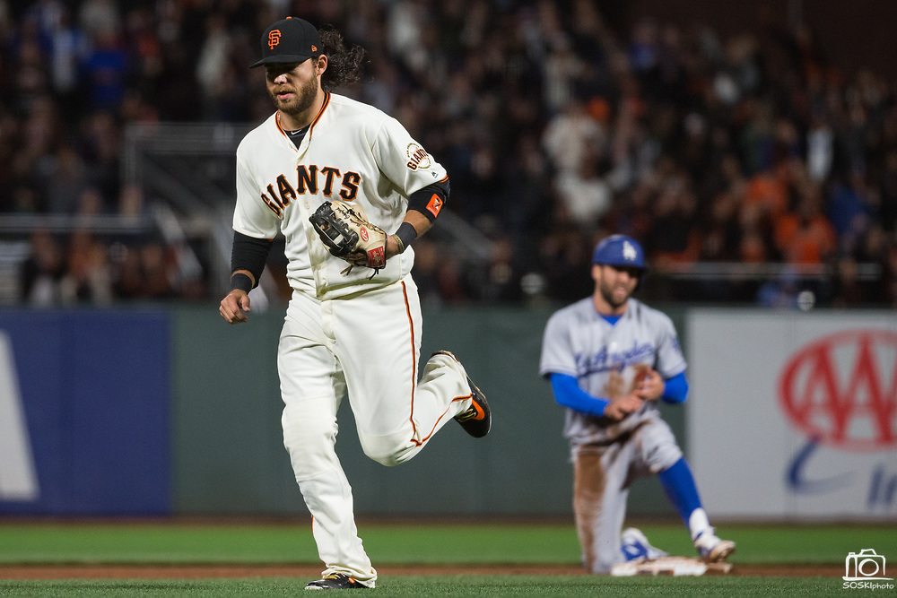 Los Angeles Dodgers third baseman Chris Taylor (3) reacts after San Francisco Giants shortstop Brandon Crawford (35) tags him out on a steal attempt at AT&T Park in San Francisco, California, on April 24, 2017. (Stan Olszewski/Special to S.F. Examiner)