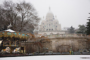 CLIMATE CHANGE. Snow, Arctic temperatures and big freeze in Paris, France. The Sacre-Coeur stands on the hill looking over Paris. Its park and steps covered with snow, beautiful as they are, have been shut to the public, because of the risks of slipping on snow and ice. Temperatures plummeted below zero, as low as -9. Very rarely, certainly not for decades, that Paris has experienced such freezing cold weather. Snow normally disappears in a couple of hours, this time it stuck around for days. Freak weather conditions and climate change can often be attributed to global warming and the ozone layer.