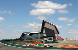 Mercedes' Lewis Hamilton drives past the grandstand during the 2018 British Grand Prix at Silverstone Circuit, Towcester.