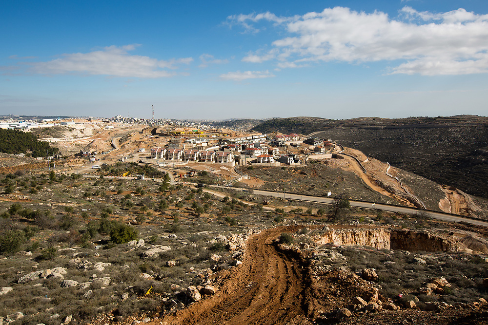 Houses under construction in Givat HaDagan, the northernmost neighborhood of the West Bank Jewish settlement of Efrat in the Gush Etzion settlement bloc, which is situated on the southern outskirts of the Palestinian West Bank city of Bethlehem, are seen from a construction site in Givat HaTamar neighborhood of Efrat, on December 30, 2016.