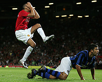 Photo: Paul Thomas.<br /> Manchester United v Inter Milan. Pre Season Friendly. 01/08/2007.<br /> <br /> Rio Ferdinand (L) of Utd covers his face in disbelief after missing a great chance to score, watched by Walter Samuel.