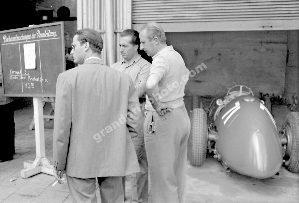 Alberto Ascari with friends and his Ferrari in the paddock before the 1951 German Grand Prix at the Nurburgring. Photo: Grand Prix Photo