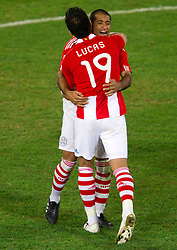 Lucas Barrios and Paulo Da Silva of Paraguay celebrate during the penalty shots after 0-0 in overtime during the 2010 FIFA World Cup South Africa Round of Sixteen football match between Paraguay and Japan on June 29, 2010 at Loftus Versfeld Stadium in Tshwane/Pretoria. (Photo by Vid Ponikvar / Sportida)