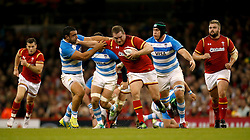 Wales' Gethin Jenkins (centre) holds off Argentina's Agustin Creevy (left) and Matias Alemanno (right) during the Autumn International match at the Principality Stadium, Cardiff.